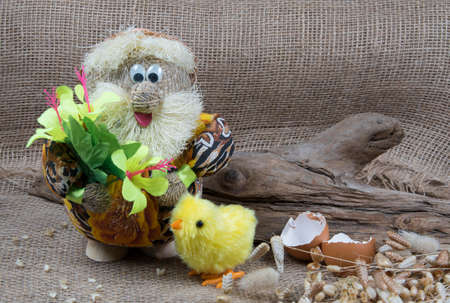 Brownie, house spirit with easter chick. Cute goblin from folk tales. Hand-made from burlap. Copyspace Stock fotó