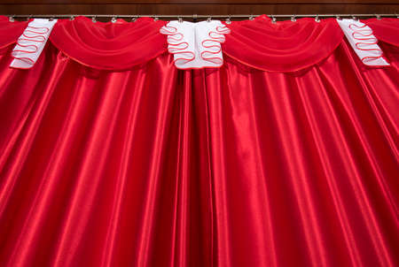 Red and white color pelmet and curtains (portiere), silk texture with folds, cloth background