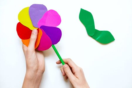 Flower at home from colored paper. Step 7. Glue the finished flower to the pencil with adhesive tape. Project for children DIY art.