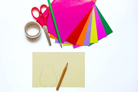 How to make a flower at home from colored paper. Colorful flower made of paper,scissors and pencil. Step 2. Draw the petal with a pencil. DIY art project for children. step by step instructions flower