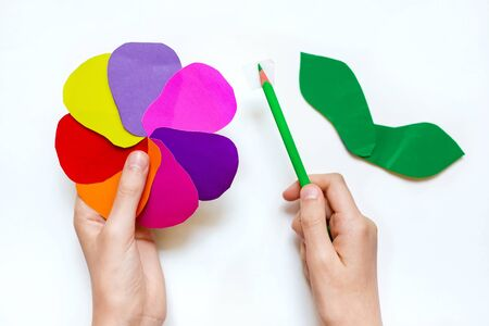 step by step instructions flower. How to make a flower at home from colored paper. Step 6. Glue a small piece of adhesive tape to the pencil, leaving free edges. Project for children DIY art.