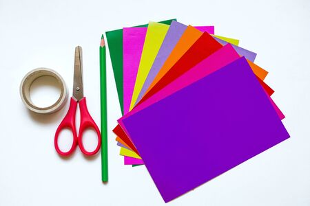 How to make a flower at home from colored paper. Step 1. Prepare 8 different sheets of colored paper, scissors, tape, green pencil. Project for children DIY art. step by step instructions flower