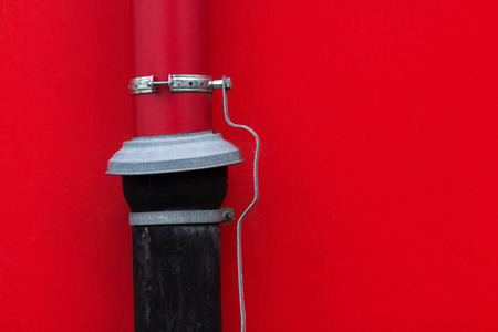 clout: Bright red wall with red and black gutter