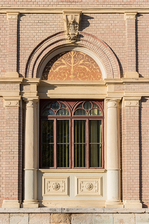 Old ornate window with in European town