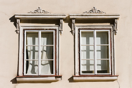 Two white windows with ornaments