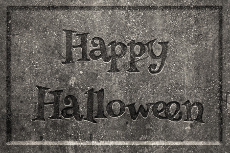 Tombstone with engraved words Happy Halloween Stock Photo