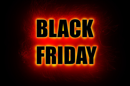 Black Friday sign, large black letters with bright red glowing outline on black background