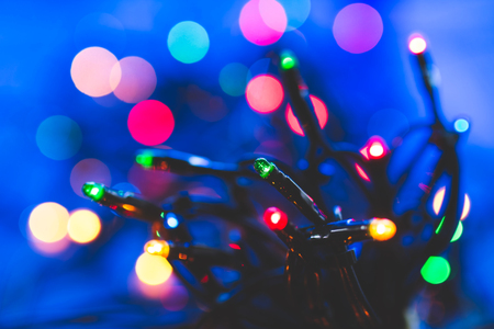 Colorful Christmas lights with some bokeh in background Stock Photo