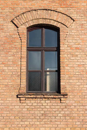 Old brick building with window with little arch above
