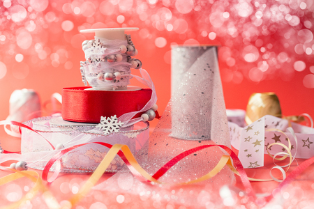 Beautiful ribbons for Christmas presents on red background and some bokeh