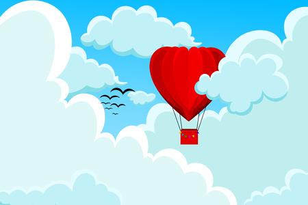 Red, heart shaped hot air balloon flying among the white clouds Stock Photo