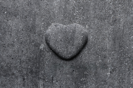 Stone heart carved into the tombstone Stock Photo