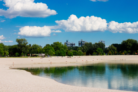 Beach by the lake on a bright and sunny day Stock Photo