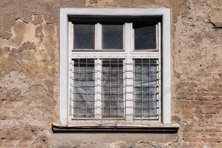 Old white framed window on an old, ruined building Stock Photo - 101383074