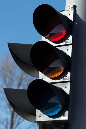 Modern traffic light on a sunny day with blue sky as background Stock Photo