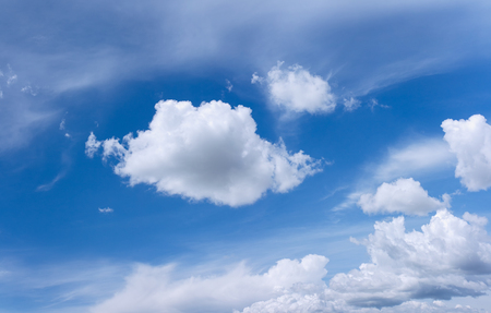 Blue sky with some white clouds scattered across Stock Photo