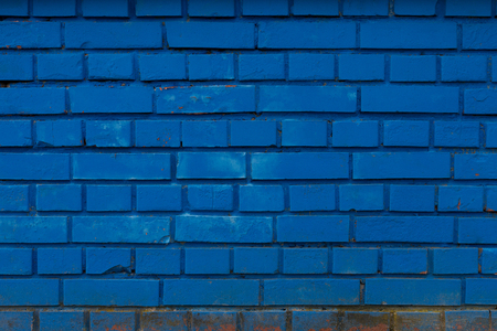 Blue brick wall, weathered and rough