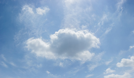 Beautiful white fluffy clouds on a blue sky on a sunny summer day Stock Photo