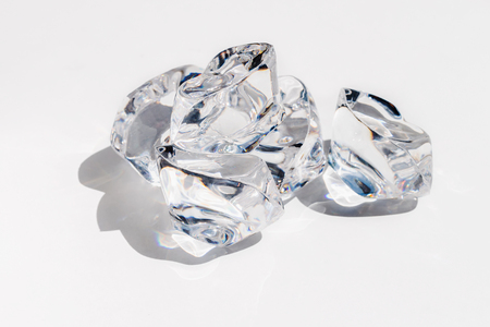 Crystal looking ice cubes on a white background