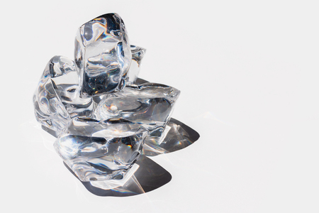 Crystal looking ice cubes on a white background Stock Photo - 104521759