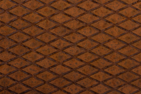 Old, orange, metal plate with diamond shaped no slip grid on it Stock Photo - 105940079