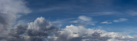 Beautiful blue sky with fluffy white clouds scattered across Stock Photo - 105940112
