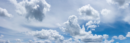 Beautiful blue sky with fluffy white clouds scattered across Stock Photo - 105940118