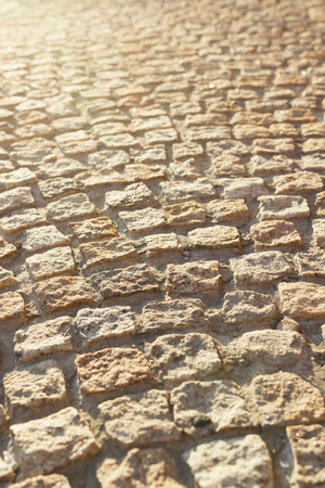 Cobblestone street in late afternoon sunlight Stock Photo