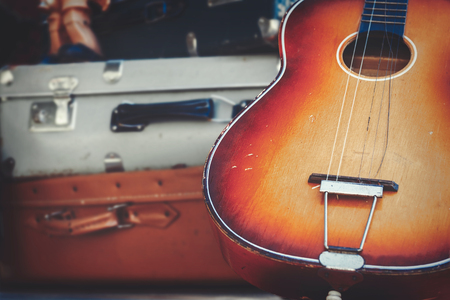 Wooden guitar and couple of old suitcases