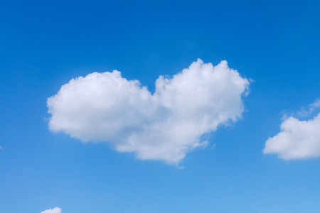 One white heart shaped cloud floating in the sky