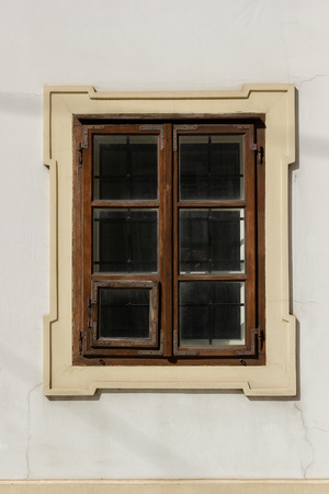 One brown window on the white wall Stock Photo