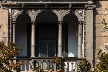Balcony with decorative arches on an old European building
