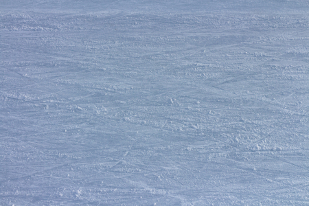 Ice surface on a frozen lake with ice skates traces and marks