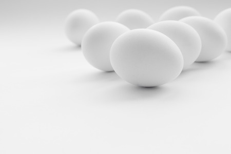 White boiled Easter eggs, uncolored on white background