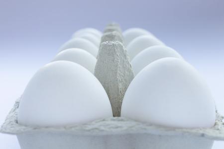 Row of ten eggs in grey carton egg holder Stok Fotoğraf