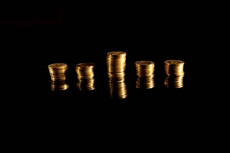 Stacks of coins on the black background