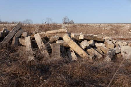 Pile of concrete blocks, concrete debris left after earthquake, overgrown with nature Reklamní fotografie