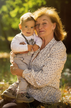 Grandmother embracing her nephew in park. Stock Photo