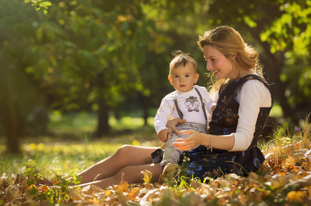Mother embracing and playing with her son in park. Stock Photo