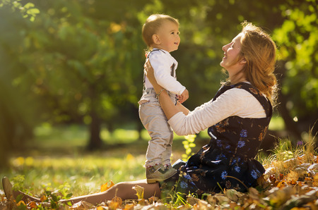beatitude: Mother embracing and playing with her son in park. Stock Photo