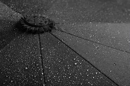 Black waterproof umbrella texture with water droplets Stok Fotoğraf