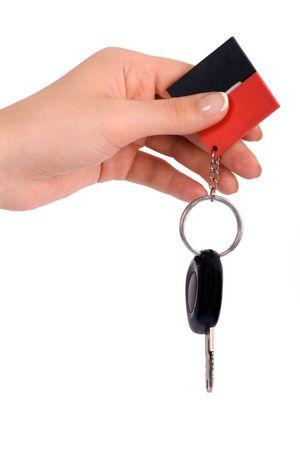 Hand holding car key photo