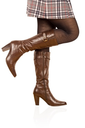 Brown womans boot isolated on white background  photo