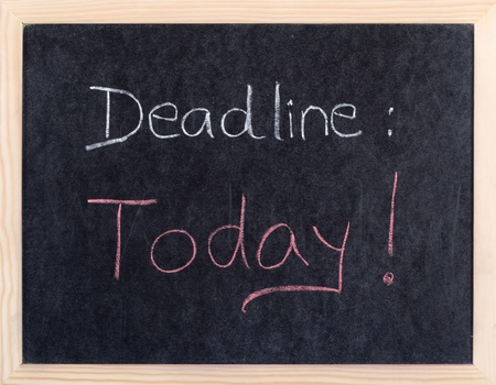 today deadline written on blackboard  Stock Photo