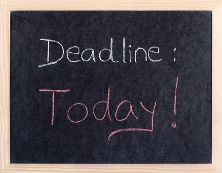 due: today deadline written on blackboard  Stock Photo