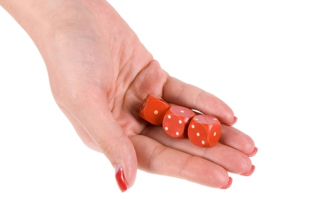 three dices in palm photo