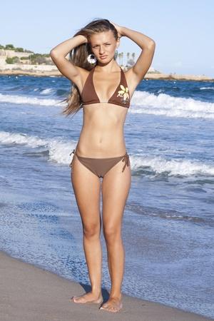 swimwear: Sexy blond girl posing on a beach  Stock Photo