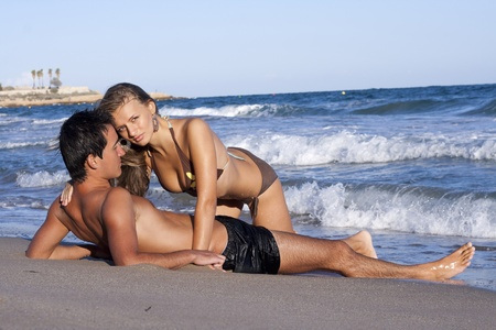 young couple relaxing on the beach  photo