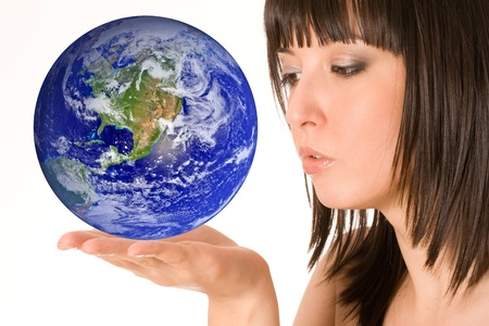 Beautiful girl with earth in hand photo