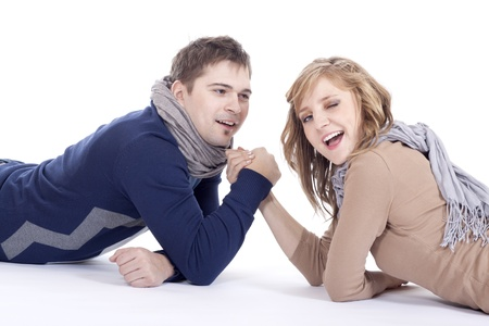man and woman doing arm wrestling photo